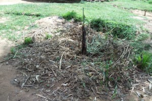 The Water Project: Muyundi Community, Ngalame Spring -  A Dumpsite At An Open Compound