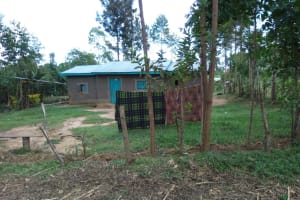 The Water Project: Muyundi Community, Ngalame Spring -  Clothes Dry On A Line In Front Of A House
