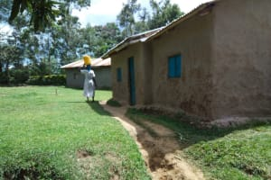 The Water Project: Muyundi Community, Ngalame Spring -  Returning Home With Water