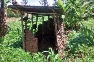 The Water Project: Ewamakhumbi Community, Yanga Spring -  Breaking Down Latrine