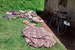The Water Project: Ewamakhumbi Community, Yanga Spring -  Clothes Left To Dry On The Ground
