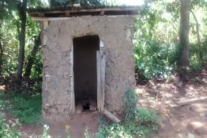 The Water Project: Ewamakhumbi Community, Yanga Spring -  Latrine With Broken Door