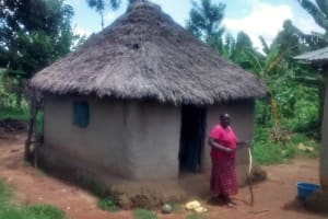The Water Project: Ewamakhumbi Community, Yanga Spring -  Woman In Front Of Home