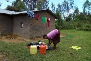 The Water Project: Chegulo Community, Werabunuka Spring -  A Lady In The Community Washes Clothes For Her Family