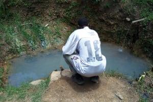 The Water Project: Chegulo Community, Werabunuka Spring -  Fetching Water
