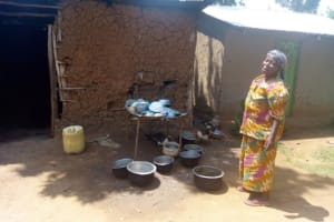 The Water Project: Isembe Community, Amwayi Spring -  A Community Member Poses Beside Her Improvised Dishrack
