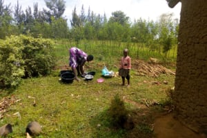 The Water Project: Isembe Community, Amwayi Spring -  Cleaning Dishes Outside