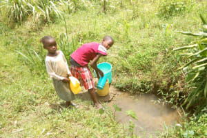 The Water Project: Emaka Community, Ateka Spring -  Children From The Community Fetching Water At Anuka Unprotected Spring