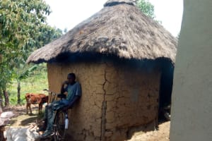 The Water Project: Emaka Community, Ateka Spring -  Young Man Sits On Back Of Bike