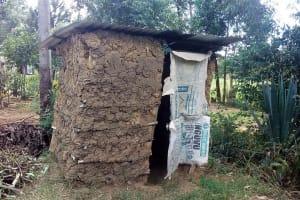 The Water Project: Lunyi Community, Fedha Mukhwana Spring -  Latrine
