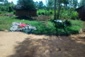 The Water Project: Shirugu Community, Jeremiah Mashele Spring -  Clothes Left On The Ground To Dry
