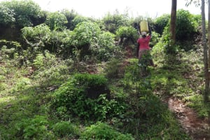 The Water Project: Ematetie Community, Weku Spring -  Walking Up The Hill With The Water