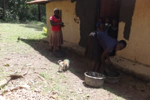 The Water Project: Ematetie Community, Weku Spring -  Washing Pots