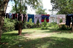 The Water Project: Ematetie Community, Chibusia Spring -  A Cloth Hangline