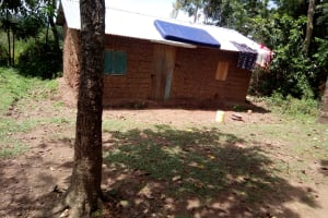 The Water Project: Ematetie Community, Chibusia Spring -  Clothes And Mattress Dry Atop Home