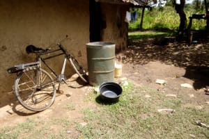 The Water Project: Ematetie Community, Chibusia Spring -  Water Drum At A Community Members Backyard