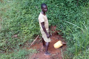 The Water Project: Asimuli Community, John Omusembi Spring -  Jerrycan Left For Filling