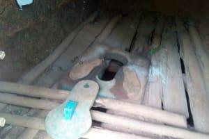 The Water Project: Asimuli Community, John Omusembi Spring -  Latrine Floor