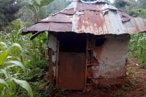 The Water Project: Asimuli Community, John Omusembi Spring -  Latrine Made Of Metal Siding And Roof