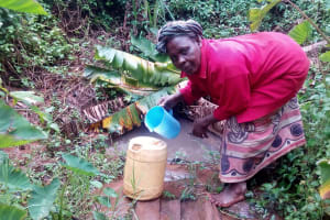The Water Project: Koitabut Community, Henry Kichwen Spring -  Pouring Water Into Jerrycan