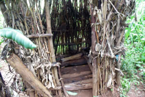 The Water Project: Chepnonochi Community, Chepnonochi Spring -  A Latrine With Dry Maize Stalks Used To Construct Walls It Has No Door Neither Does It Have A Roof