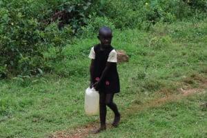 The Water Project: Chepnonochi Community, Chepnonochi Spring -  Child Carrying Water Container