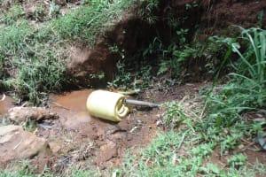 The Water Project: Chepnonochi Community, Chepnonochi Spring -  Jerrycan Fills With Spring Water