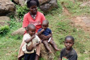The Water Project: Chepnonochi Community, Chepnonochi Spring -  Mary Amboka With Her Kids Use Water From Chepnonochi Spring