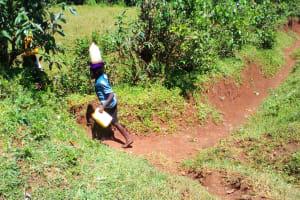 The Water Project: Upper Visiru Community, Wambosani Spring -  Children Bringing Water Home