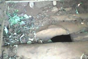 The Water Project: Upper Visiru Community, Wambosani Spring -  Latrine Floor