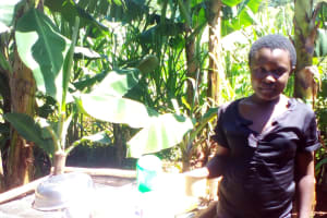 The Water Project: Upper Visiru Community, Wambosani Spring -  Woman And Dish Drying Rack