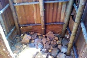 The Water Project: Upper Visiru Community, Wambosani Spring -  Bathroom Floor