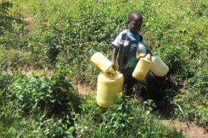 The Water Project: Emasera Community, Visenda Spring -  A Child In The Community Heads To The Spring
