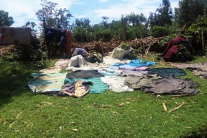 The Water Project: Emasera Community, Visenda Spring -  Cloths Left To Dry On The Ground