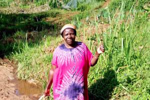 The Water Project: Irumbi Community, Shatsala Spring -  Woman Poses At Shatsala Spring