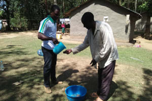 The Water Project: Bukhunyilu Community, Solomon Wangula Spring -  Hand Washing Training