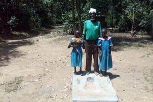 The Water Project: Maganyi Community, Bebei Spring -  Sanitation Platform