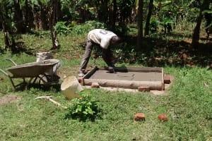 The Water Project: Ivulugulu Community, Ishangwela Spring -  Sanitation Platform Construction