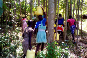 The Water Project: Chebunaywa Primary School -  Fetching Water For Construction
