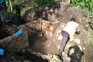 The Water Project: Bukhunyilu Community, Solomon Wangula Spring -  Spring Construction