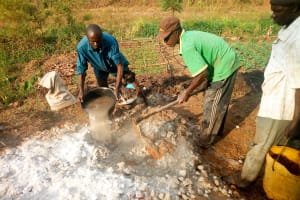 The Water Project: Esembe Community, Chera Spring -  Mixing Concrete