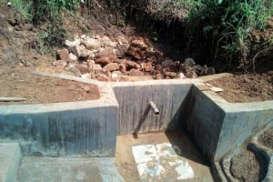 The Water Project: Ikonyero Community, Jesse Spring -  Filling In The Spring Box