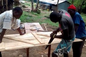 The Water Project: Lihanda Secondary School -  Working On The Latrine Door