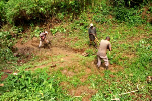 The Water Project: Elukani Community, Ongari Spring -  Digging Drainage