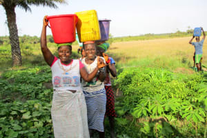 The Water Project: Kipolo Community -  Carrying Water For Drilling