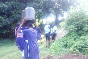 The Water Project: Shiru Primary School -  Carrying Water Back To School