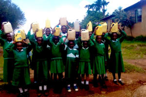 The Water Project: Erusui Girls Primary School -  Carrying Water