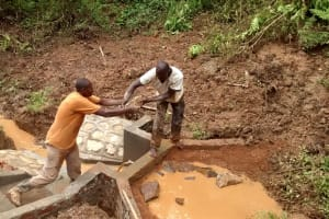 The Water Project: Elukani Community, Ongari Spring -  Filling In The Spring Box