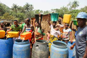The Water Project: Sanya Community -  Community Members Getting Water
