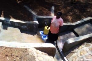 The Water Project: Mwichina Community, Mwichina Spring -  Jacklne Okunyanyi Fetching Clean Water